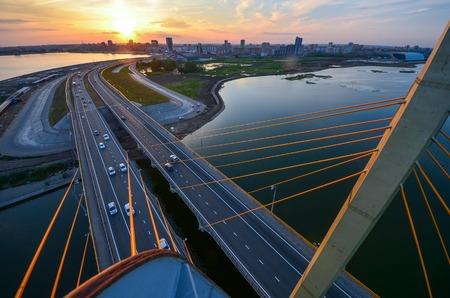 Millenium bridge in Kazan aerial view at sunset time with panoramic view of Kazan city. Stock Photo