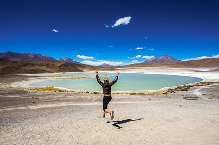 avaroa: Girl runing on the Laguna Verde is a salt lake at the foot of the volcanos Licancabur and Juriques - Eduardo Avaroa Andean Fauna National Reserve, Bolivia