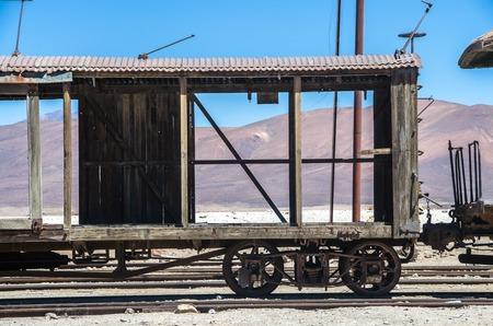 Old railway in Salar de Uyuni (salt flat), Bolivia. Abandoned train near Chile border in Atacama desert