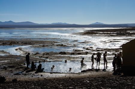 avaroa: Tourist swiming near Geyser Sol de Manana, Potosi department, Euardo Avaroa natural reserve, south Bolivia Stock Photo