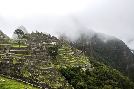 Mountains at Machu Picchu Lost city of Inkas in Peru with fog and cloudy