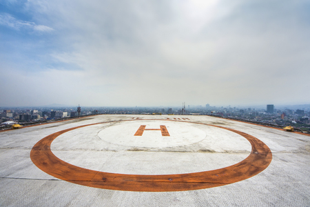 Helipad on roof top building 스톡 콘텐츠