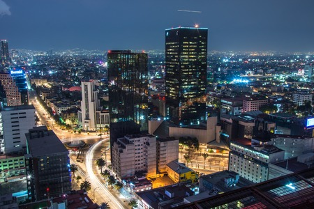Panoramic view of Mexico city downtown skyscrappers at sunset time before night.