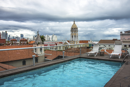 Swimming pool view of the old city skyline of Panama City , Panama. View from the top of building