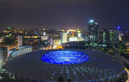 Panorama of kyiv city center, NSC Olympiysky Stadium of Kiev, Ukraine. Old and modern architecture in capital city of Ukraine, beautiful landscape of Kiev city center Stock Photo