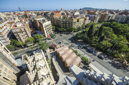 Aerial Panorama view of Barcelona city with details, skyline and Sagrada familia at dusk time,Spain