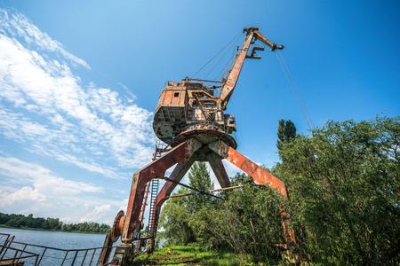 Old crane over Yanov Backwater in Chernobyl Exclusion Zone, Ukraine Stock fotó