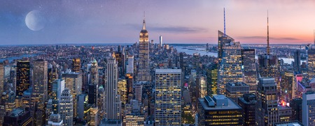 Manhattan wide panorama, with moon and sunset. New York, USA