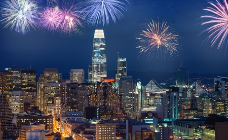 Downtown San Francisco cityscape with flashing fireworks Celebrating New Years Eve