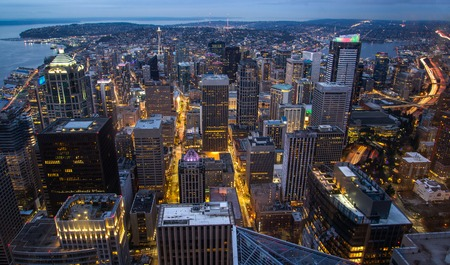 View of skyscrapers in downtown at night, in Seattle, Washington. Rooftop panorama of night Seattle