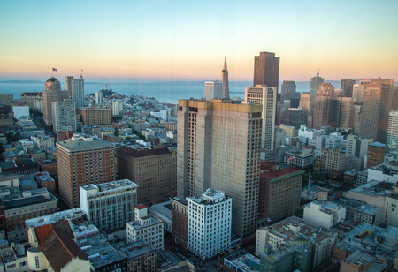 Beautiful view of business center in downtown San Francisco at sunset. Orange background city San Francisco