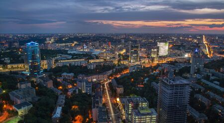Foot bridge cross the Dniper river , Kiev, Ukraine Panorama view of the city Kyiv at dusk Imagens
