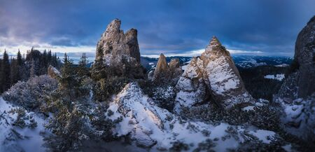 Mountain Peaks. Winter mountains with sunrise light. Carpatian mountain at Romania Standard-Bild