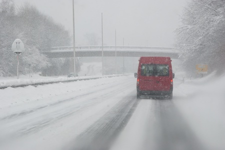 road conditions: Driving with bad weather conditions: road is covered by snow