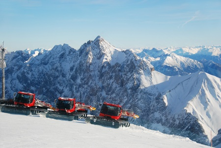 Piste preperation vehicles with view over the alps Stock Photo - 9948423