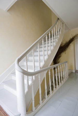 Indoor Staircase and handrail leading to upper floor photo