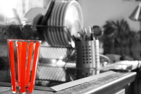 Colorkey glas with black and white background. There are some more dishes blurred as well photo