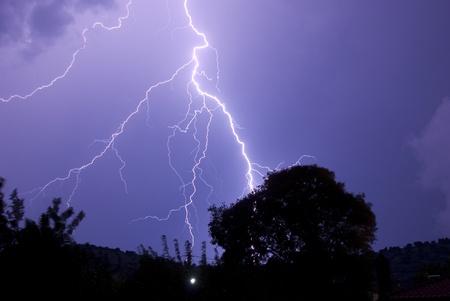 Thunderstorm with lightening at night. Imagens