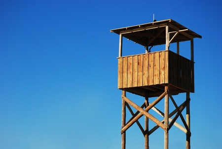 baywatch: Wooden stand against blue sky Stock Photo