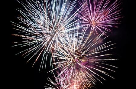 light zoom: Bright fireworks in the dark sky Stock Photo