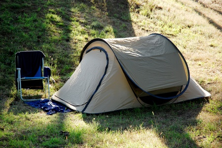 Small tent and chair. outdoor setup photo