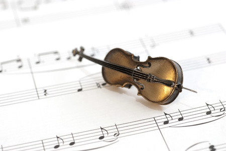 Classical instrument (Cello) placed on music sheet. Concert Concept photo