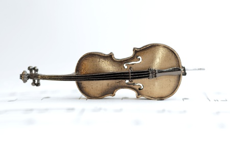 fiddle: Classical instrument (Cello) placed on music sheet. Concert Concept Stock Photo