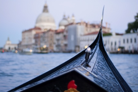 those: gondola trip during evening on canale grande, venice, italy, europe. In te earlier days those famous gondolas were colorful but Napoleon made them change to black Stock Photo