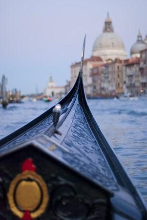 gondola trip during evening on canale grande, venice, italy, europe. In te earlier days those famous gondolas were colorful but Napoleon made them change to black photo
