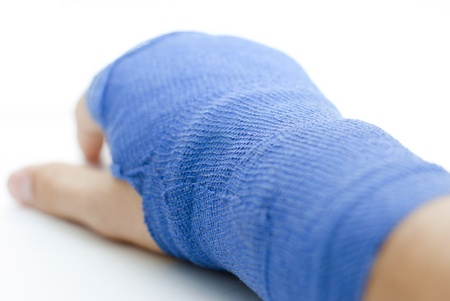 bandaged broken hand on white background and shallow depth of field Stock Photo