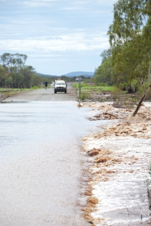 Hazardous road conditions due to flooding during rain season in Western Australia. photo
