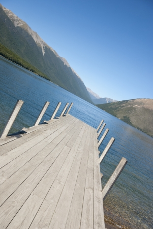 Jetty on Lake Rotoiti in the Nelson Lakes District with mountains, South Island, New Zealand.  photo