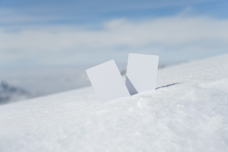 Two blank winter sport ski pass tickets with scenic background. Concept to illustrate Wintersport admission fee