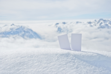 wintersport: Two blank winter sport ski pass tickets on mountain top. Concept to illustrate Wintersport admission fee