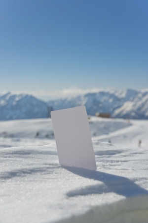 wintersport: Ski lift pass stuck in snow ready for your design. Concept to illustrate Wintersport admission fee Stock Photo