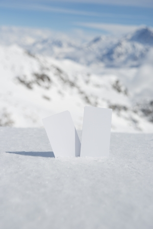 wintersport: Two blank winter sport ski pass tickets with scenic background. Concept to illustrate Wintersport admission fee