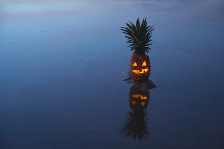 Jack o lantern halloween pinapple with reflection photo