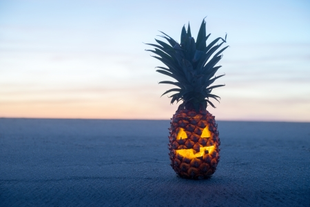 pumpkin head: Halloween on Beach. Pinapple jack o lantern