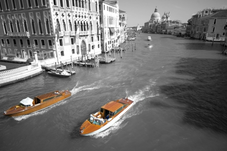 trafic: Two Venice taxi boats colorkey New York cab style with typical city trafic, Academia Bridge, Canal Grande, Italy, Europe Stock Photo