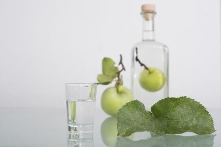 williams: Apple inside bottle filled with liqeur, schnapps or Obstwasser