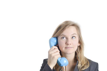 Attractive blond businesswoman with suit on the phone looking at imaginary dialogue. Copy space