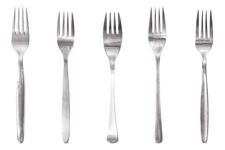fork lineup of different restaurant cutlery photo