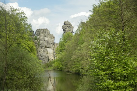 mystic place: The Externsteine sandstone rockformation with Wiembecke pond in the Teutoburg Forest Horn-Bad Meinberg, Germany Stock Photo