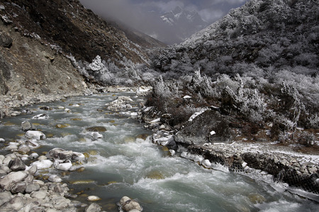 flowing river: Flowing river in winter