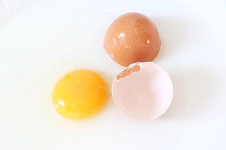 an egg shell: Egg yolk and egg shell Stock Photo