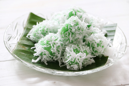 Malaysian traditional kuih Ondeh Ondeh or Kelepon in Indonesia, made of glutinous flour with palm sugar filling Фото со стока