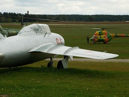 mig: In airfield the helicopter, in the foreground the trainer aeroplane Mig - 15uti