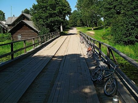 On wooden bridge beside banisters  bicycle group  photo