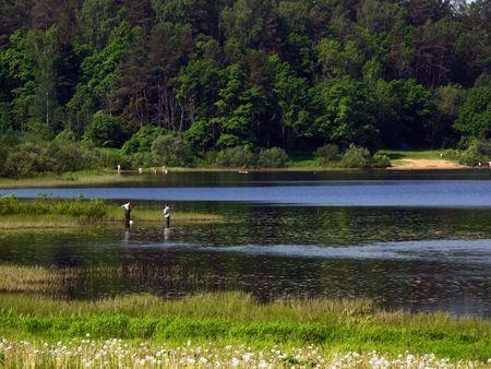 looking ahead: on average plan stand fishermens - afield swiming people