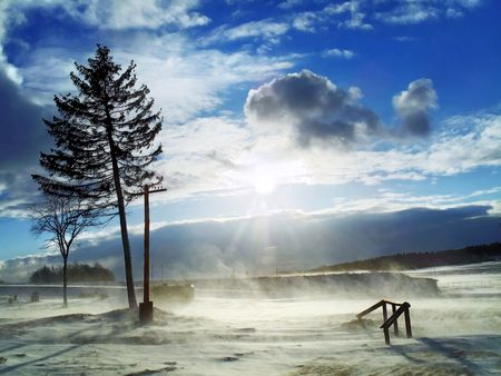 interleaved: february snowstorm - blue sky is interleaved with snow clouds Stock Photo